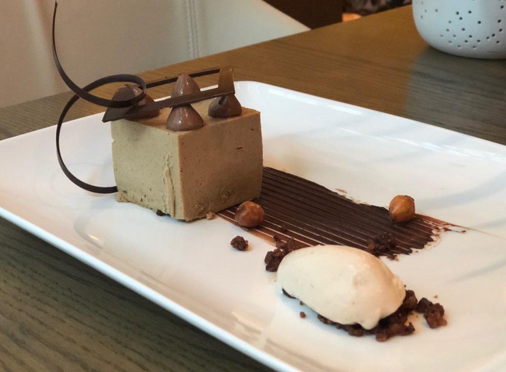 Chocolate and Coffee Cube with black cardamom cremeux, praline feuilletine, baklava ice cream